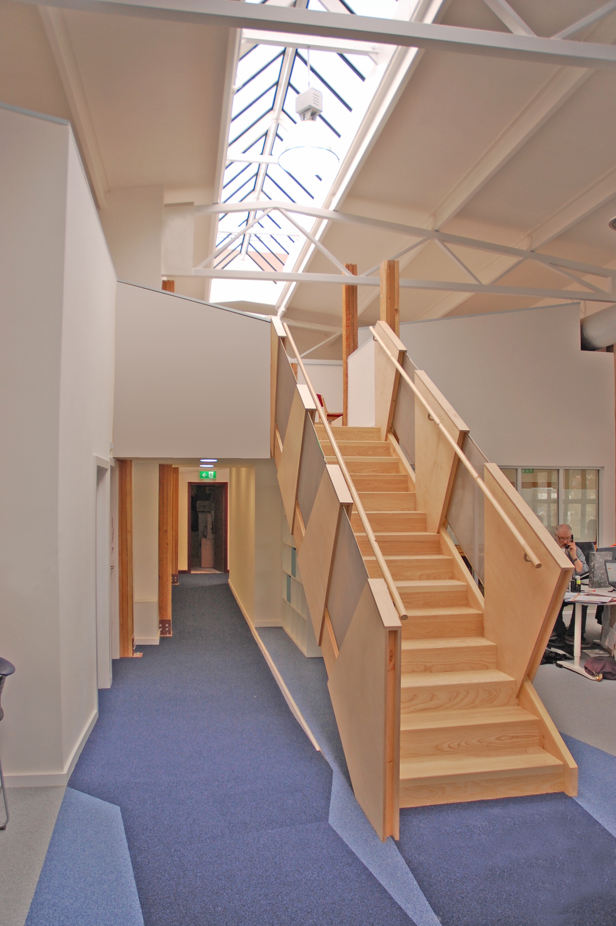 Designed using pencil and CAD, this stair is constructed around a simple ash carcass, with alternating panels of birch ply and stainless steel