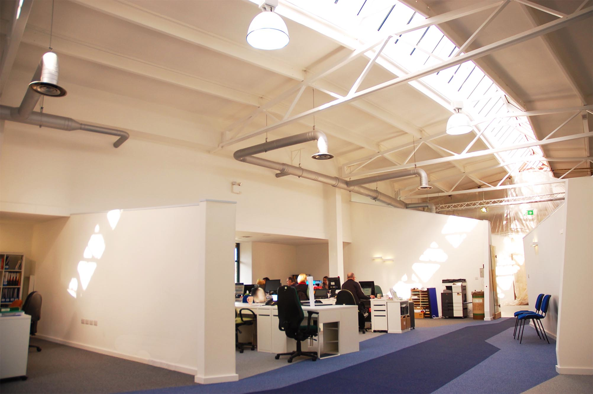 What was a dingy warehouse is transformed into a generous, clean, energising place to work.